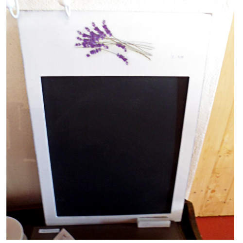 Blackboard with a white background and lavender images