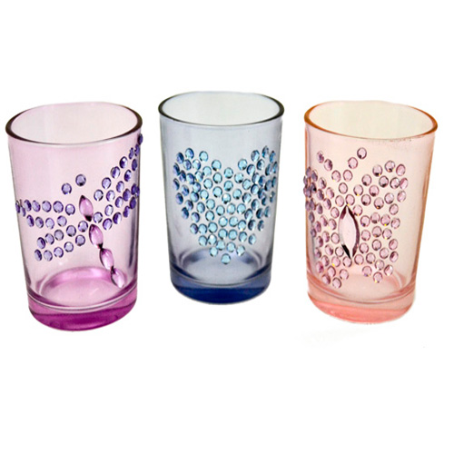 Decor glass tea light holders, come is a set of three, and have sparkle designs on the glass jars