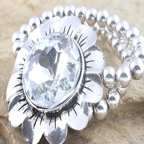 Over-Sized Metal Flower Bracelet with large facetted Rhinestone on a double row bead bracelet