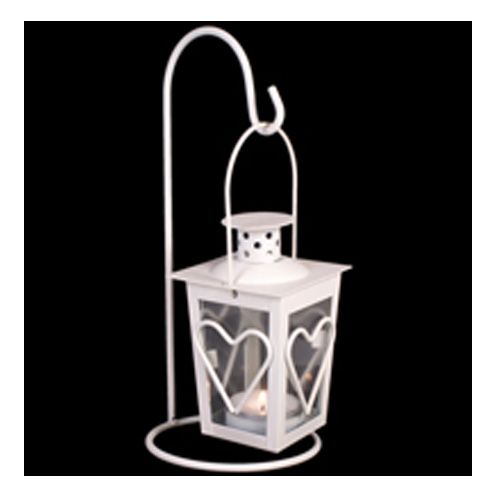 White mini metal lantern with heart detail on a swing
