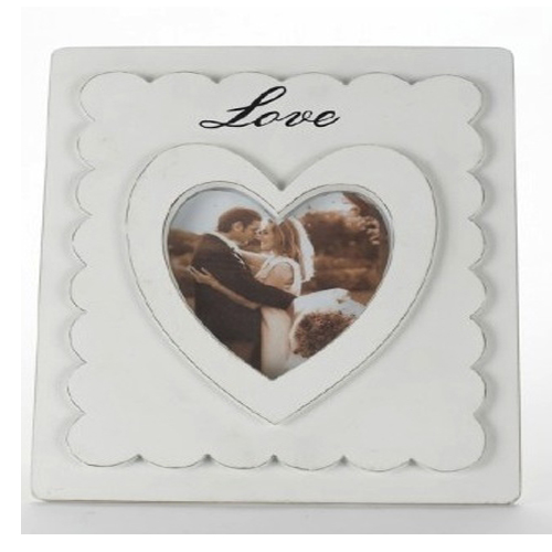 White wooden double photo frame with a heart window for photo